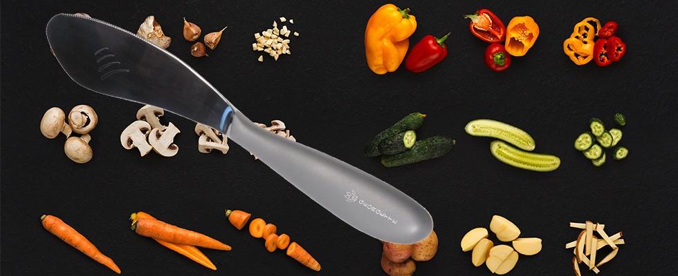 Le GEORGE manche mat avec en arrière plan de multiples légumes émincés